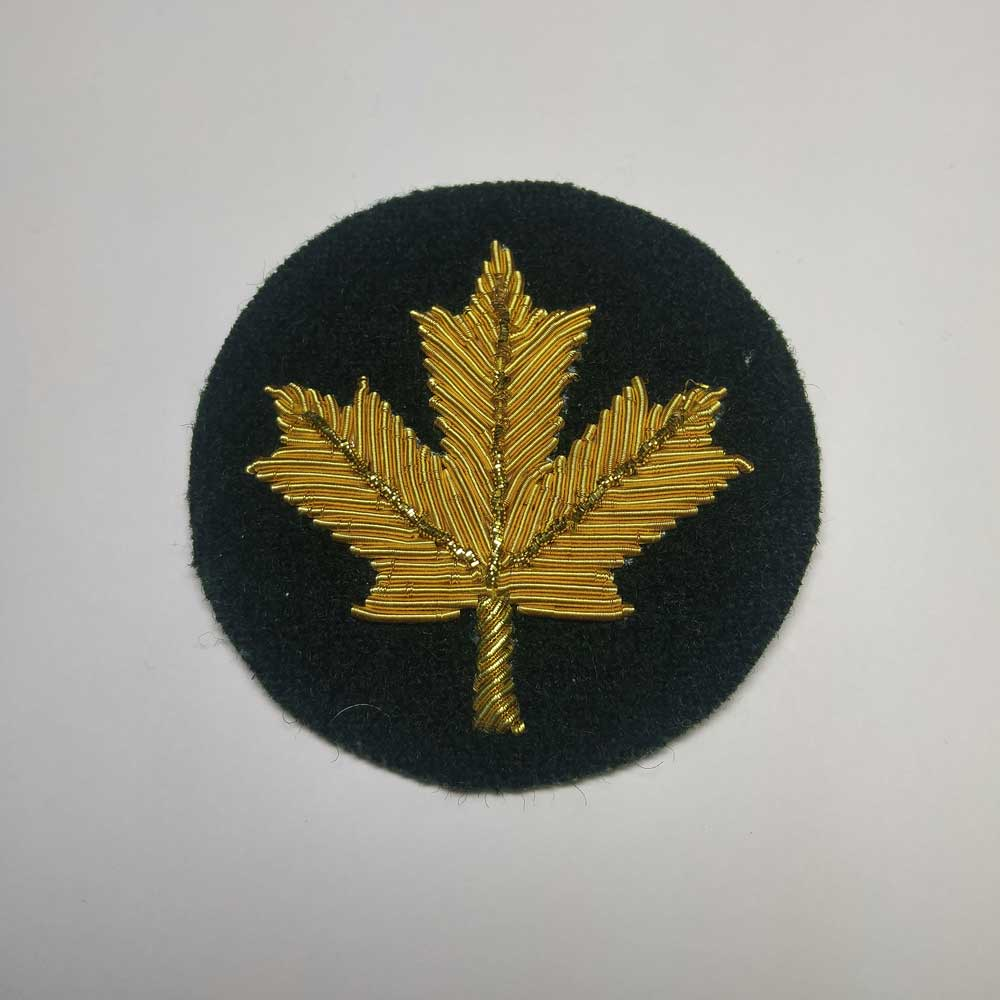 Turnback Tacks: Maple Leaf, Gold with Green Backing