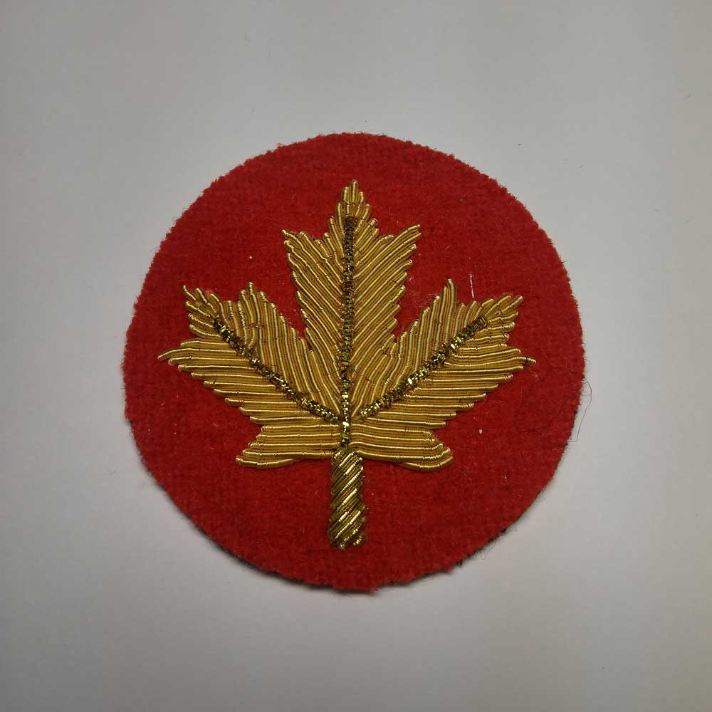 Turnback Tacks: Maple Leaf, Gold with Red Backing